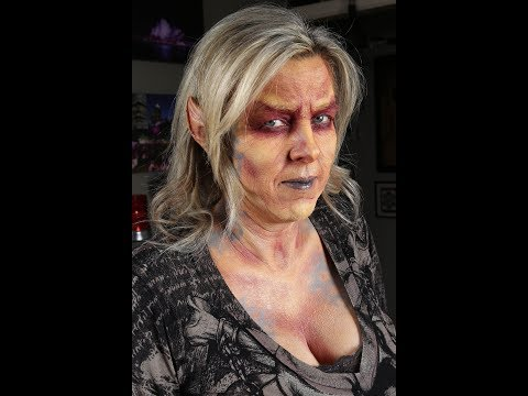Female Imp face painting and foam latex ear application by Shelly Denning