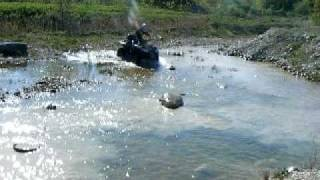 7. arctic cat atv playing in water