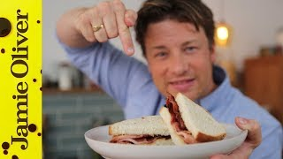 Jamie Oliver cooks up the perfect breakfast treat - a bacon sandwich. Yes, essentially it's bacon rashers between two slices of bread, but Jamie adds his ...