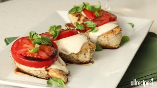 Get the recipe for Caprese Chicken at: http://allrecipes.com/recipe/229605/caprese-chicken/ Make it Mediterranean night with this super-tasty chicken entrée! After marinating chicken breasts in a zesty mixture of Italian salad dressing, Italian herb seasoning and Montreal chicken seasoning, sear chicken to seal in juices, then bake. Top with mozzarella cheese and tomato and bake again until melty and tempting. Serve with fresh basil and a drizzle balsamic for an exceptional flavor!Subscribe to Allrecipes @ http://www.youtube.com/subscription_center?add_user=allrecipesAllrecipes Magazine is now available!U.S. subscribers, subscribe here: http://armagazine.com/subscribenowCanadian subscribers, subscribe here: http://themeredithstore.ca/p-282-allrecipes-subscription.aspxFacebookhttp://www.facebook.com/AllrecipesTwitter @Allrecipes