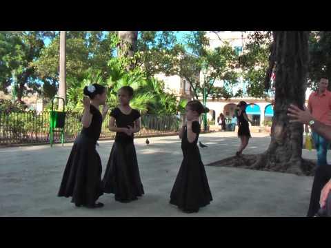 Group of girls practicing flamenco dancing at the Plaza de Armas in Havana