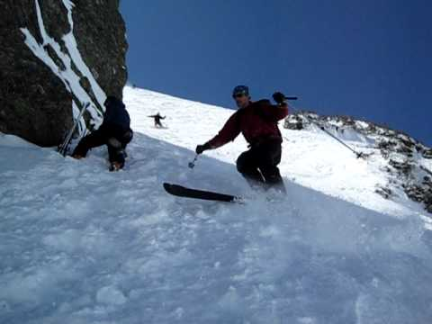 A woman slides down Mount Washington face first