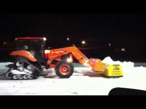 Kubota M126X Power Krawler with Snow Pusher