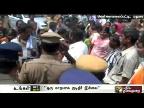 Road-roko-by-residents-on-the-Usilampatti-Vathalagundu-high-road-demanding-water-supply