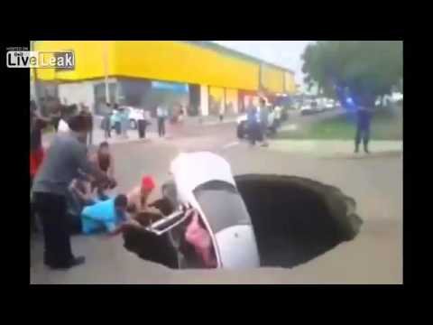 Massive sinkhole swallows car