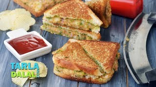 Potato Sandwich,Recipe Link : https://www.tarladalal.com/Potato-Sandwich-Aloo-Sandwich-On-A-Tava-Indian-Snack-41930rSubscribe : http://goo.gl/omhUioTarla Dalal App: http://www.tarladalal.com/free-recipe-app.aspxFacebook: http://www.facebook.com/pages/TarlaDalal/207464147348YouTube Channel: http://www.youtube.com/user/TarlaDalalsKitchen/featuredPinterest: http://www.pinterest.com/tarladalal/Google Plus:  https://plus.google.com/107883620848727803776Twitter: https://twitter.com/Tarla_DalalPotato Sandwich, Aloo Sandwich on a Tava, Indian SnackScrumptious and satiating, the Potato Sandwich is the ideal snack to appease your hunger! Buttery, chutney-lined bread is sandwiched with a tasty potato mixture and toasted on a tava till it is appetizingly crisp and golden. The potato filling is very tasty, as it is boosted with flavourful ingredients like onion, coriander, chaat masala and lemon juice. Although it is a common snack that is enjoyed by everybody, this is nothing short of a work of art because it so masterfully combines taste and functionality. The next time you feel hungry, think no further – just go for a Potato Sandwich.Preparation Time:  15 minutes.Cooking Time:  10 minutes.Makes 4 sandwiches. To be mixed into a stuffing 2 cups boiled and mashed potatoes ½ cup finely chopped onions ¼ cup finely chopped coriander (dhania) 2 tsp finely chopped green chillies 1 tsp chilli powder1 tsp chaat masala2 tsp lemon juiceSalt to taste Other ingredients 8 bread slices 8 tsp green chutney 6 tsp butter for spreading and brushing 4 tsp butter for cooking For serving Tomato ketchup 1. Divide the stuffing into 4 eqaul portions. Keep aside. 2. Place 2 bread slices on a clean, dry surface, apply ½ tsp of butter on both the bread slices and spread it evenly. 3. Put 1 tsp of green chutney on both the buttered bread slices and spread it evenly. 4. Put a portion of the stuffing on one buttered- chutney slice and sandwich it with another buttered-chutney slice facing downwards and pres