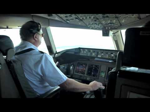 B777 - Video footage taken from flight deck of Boeing 777-200 approach into Auckland from the west. Tracking over Auckland city out to the east then landing at Auck...
