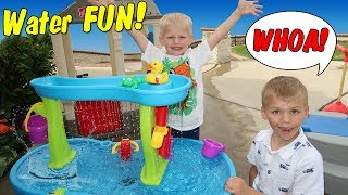 """Chris and Michael had a fun afternoon playtime. Their water table playtime became a fun water fight that cooled them off on a hot summer day.  They enjoyed their roller coaster, hide and seek and playtime with Michael's new Step2 Rain Showers Splash Pond Water Table.  Thanks for watching!  Don't forget to give us a THUMBS UP! Please subscribe to our channel & the kids' channels!http://bit.ly/FFPSubscribehttp://bit.ly/AlwaysAlyssaSubscribehttp://bit.ly/SubDudeItsDavidhttp://bit.ly/SubTwinTimehttp://bit.ly/SubMichaelsMPShop our video: Step2 Rain Showers Splash Pond Water Table http://go.magik.ly/ml/5lwj/Step2 Up & Down Roller Coaster Ride-on http://go.magik.ly/ml/17r5/* The above links are affiliate links, which means we may receive a commission for purchases made through our links.Want to send fan mail?  You can find our address in our """"about"""" section here on YouTube.Find pictures, updates, and more about Family Fun Pack: Facebook: http://bit.ly/FamilyFunFBTwitter: http://bit.ly/FamilyFunTwitterInstagram: http://bit.ly/FamilyFunIGMatt's Instagram: http://bit.ly/DaddyFunPackIGMatt's Twitter: http://bit.ly/DaddyFunPackAlyssa's Instagram: http://bit.ly/2dLKBE6David's Instagram: http://bit.ly/2dsNQAmZac's Instagram: http://bit.ly/2dL1JocChris' Instagram: http://bit.ly/2dL34vVMichael's Instagram: http://bit.ly/2cTen8zNew videos posted daily! Challenges, Epic Road Trips, Vlogs, Toys,  Clothes, Food, and lots of other fun things!  Family Fun Pack is a family of 6 kids: Alyssa, David, Zac & Chris, all born within 39 months of each other.  After those four, we had our precious son Michael and then our sweet new baby Owen!  Our motto is """"fun with the family, every day""""! We like to do videos with Play Doh, Costumes, Superheros, Hot Wheels, Surprise Eggs, holidays like Easter, Halloween & Christmas, we have fun birthday parties, we love indoor playgrounds and outdoor playgrounds, bounce houses, parks, water parks, Disneyland, Legoland, Legos, water toys, Thomas trains, play hous"""
