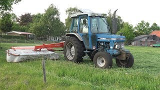 Een Ford 5610 Gen 2 's avonds aan het maaien met een Kuhn FC 243 Lift Control achtermaaier.Het gras werd enkele dagen later in balen geperst en gewikkeld.A Ford 5610 Mark II busy mowing in the evening with a Kuhn FC 243 Lift Control rear mower.A few days later the grass was pressed and wrapped into bales.22 mei 2017© copyright by NAGD2010. All rights reserved.The video's and/or fragments of it, may NOT be downloaded, edited, altered, or re-uploaded without my permission.