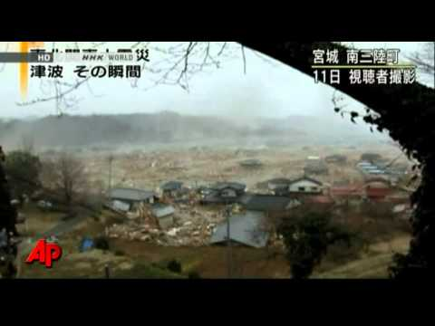 Raw Video: Tsunami Arrives, People Flee