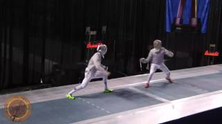 This is a semifinal bout in the men's sabre event at the NCAA fencing championships in Indianapolis, Indiana. Ben Natanzon of St. Johns University is on the right and Eli Dershwitz of Harvard University is on the left.