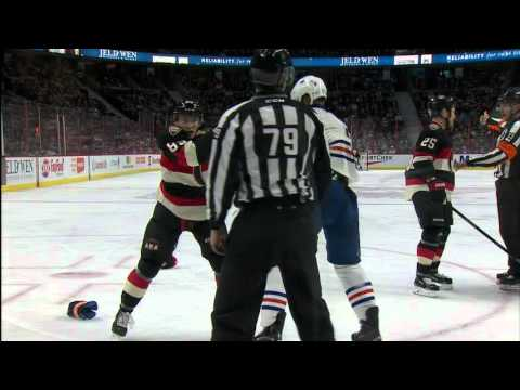 Mom and dad cheer son's hockey fight
