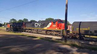 CN 2170 and 2004 leading a northbound manifest through Brookhaven on the former Illinois Central main line. He gets a...