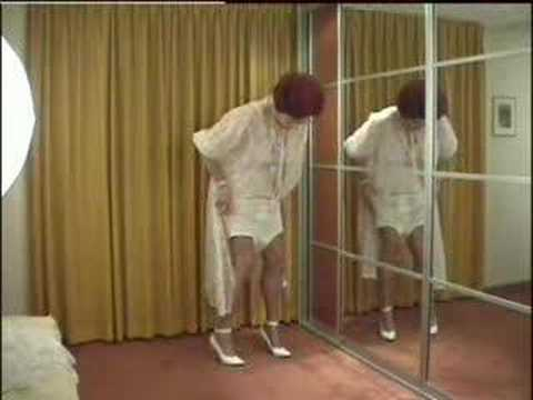 wandanylon - Mrs. Wanda Nylon changing from her white nylon negligee, worn over her all in one girdle, changing to white slips and bloomers.