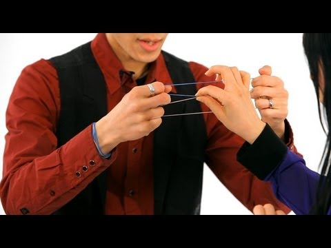 How to Do the Linking Rubber Band Trick | Magic Tricks