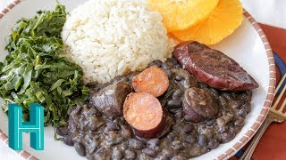 """Check out Hilah's Happy Hour - my new weekly podcast! http://vid.io/xca1Making feijoada with friends from Brazil! Feijoada is a Brazilian specialty of beans, meat, rice, collard greens. Feijoada recipe below Check out my podcast http://hilahcooking.com/category/podcast-hilahs-happy-hour/Subscribe on iTunes bit.ly/HilahsHappyHourMy top secret newsletter http://hilahcooking.com/top-secret-newsletter/Subscribe to be notified when I release a new video! https://www.youtube.com/subscription_center?add_user=hilahcooking  Feijoada recipe at http://hilahcooking.com/feijoada/ Feijoada Ingredients:1 pound black beans24 ounces mixed, smoked sausages (see notes above) sliced12 ounces """"feijoada mix"""" or salt pork, optional1 onion3 cloves garlic1/2 cup chopped cilantro1 teaspoon oilRice:2 cups parboiled white rice1-2 cubes chicken bouillon6 cups hot water, dividedGreens:2 bunches collard greens1 tablespoon oil2 cloves garlic1/2 teaspoon chicken bouillonGarnish:Farofa (toasted tapioca flour)peeled, sliced orangesFeijoada instructions:Soak the beans for 12 hours in enough water to cover them. Drain. Add to a large pot with about 8 cups water. Cover and bring to boil.Meanwhile, start the rice. Put rice into a medium-large pot with bouillon and 4 cups of hot water. Bring to boil over high heat, then reduce to medium and let it simmer uncovered. Stir occasionally and add hot water as needed. Cook this way for about 15 minutes or until rice is tender. Let simmer 5 more minutes until the liquid has evaporated. Cover and set aside.Once the beans have come to a boil, boil for 30-40 minutes or until softened. Add the meat. Cook another 30 minutes or until the beans are tender.In a small pot, saute the onion, garlic and cilantro in the oil for a minute until the onion is fragrant. Add about a cup of the bean-cooking liquid and boil. Turn off heat and let cool.Begin the collard greens. Wash and remove the stem from each leaf. Stack 4-5 leaves, roll them into a """"cigar"""" and thinly slice to make"""