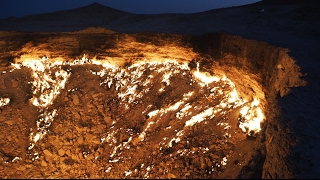 Join our visit at Door to Hell in Derweze, Turkmenistan - the gas crater that has been burning non-stop since 1971. Enjoy! This is...