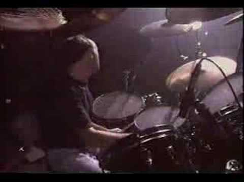 Drums - Genesis members Phil Collins and Chester Thompson perform a flawless drum duet. Drum War at Genesis