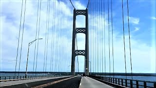 """A $4 toll lets you drive over this bridge.   According to mackinacbridge.org:   """"The Mackinac Bridge is currently the fifth longest suspension bridge in the world. In 1998, the Akashi Kaikyo Bridge in Japan became the longest with a total suspension of 12,826 feet. The Mackinac Bridge is the longest suspension bridge in the western hemisphere.The total length of the Mackinac Bridge is 26,372 feet. The length of the suspension bridge (including anchorages) is 8,614 feet. The length from cable bent pier to cable bent pier is 7,400 feet. Length of main span (between towers) is 3,800 feet."""""""