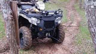 9. Polaris Sportsman 570 recovering dead cow