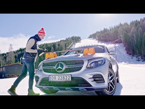 HappyNorwegian jumping over Mercedes