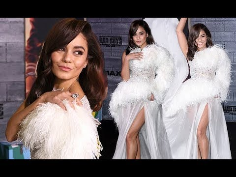 Vanessa Hudgens turns heads in a dramatic white feathered gown as she hits the red carpet for the fi