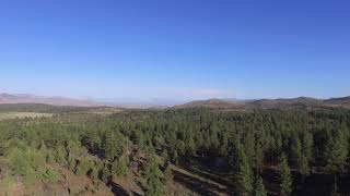 "I put this Phantom 3 Standard drone up on a mountain pass in the Modoc-Lassen National Forest and took some video. I did not notice the smoke from the forest fire in the distance to the south until editing the video. I believe this is the start of the fire currently burning near Lakeview, Oregon.If you do fly in national forests out west, be aware that forest fires become ""no-fly zones"" as soon as they start under current regulations due to the low-flying aircraft that fight them. This fire would not be within that zone."