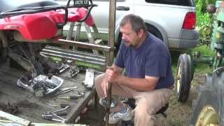2. Arctic Cat 250 Axle Replace