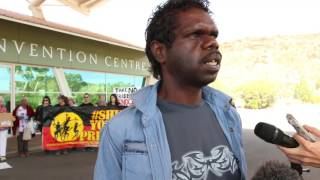 At the start of the Royal Commission hearings, the audience outside the Convention centre in Alice Springs listened to Josh Poulson share some of his experience with Children's services removing children from his family.