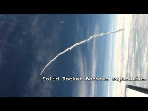 A Space Shuttle Launch Seen From A Plane Is