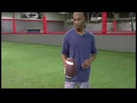how to be better at football - In order to throw a football better, a player should know how to properly hold a football. Throw a football better with tips from a football coach in this fr...