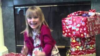 Girl opens kitty Christmas present