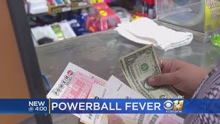 Lottery players across the U.S. are scooping up $2 Powerball tickets in hopes of beating the odds and winning a massive $700 ...