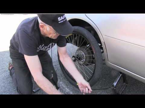 Bicycle - Shows how a bicycle wheel can be built strong enough to support a car. Bill Mould partnered with Bryan Higgins, a high school senior, to build and install a ...