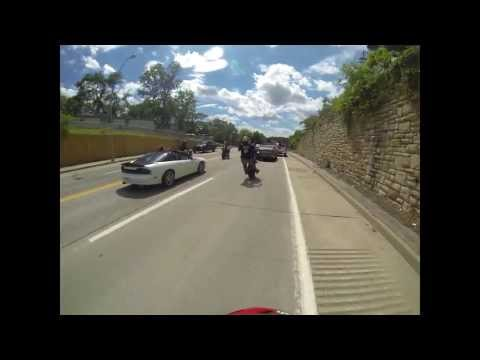 Motorcycle rider hits a cop car while doing a wheelie