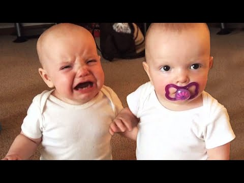 VIRAL: Twin babies fight over a pacifier!