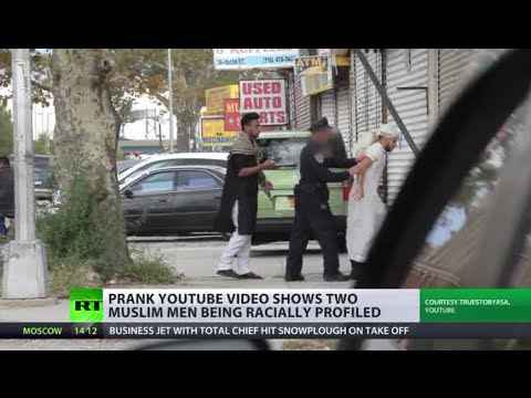 racial - Pranksters on YouTube have highlighted the problem of racial profiling in the US. This video first shows two young men in jeans and T-shirts arguing in English. A policeman is standing close...