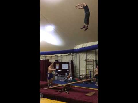 Two performers from Cirque Du Soleil practice some amazing teeterboard stunts.