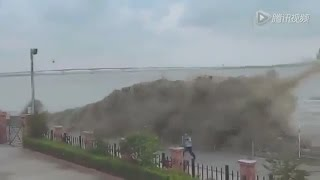 """Every fall, thousands of tourists flock to China's Qiantang River in the City of Hangzhou to get drenched by the strongest tidal bore in the world, known as the Silver Dragon. But a tidal bore, an unusually strong tide that pushes up a river or inlet, is nothing to be taken lightly.Tidal bores form on rivers with big tidal swings from, say, 13 to nearly 20 feet, Hubert Chanson, a professor of hydraulic engineering at the University of Queensland in Australia, told NPR. When the gravitational pull of a full or new moon raises the water level at the river's mouth especially high, it triggers a wave that rolls upstream.The effect is magnified on the Qiantang, NPR reports, because the triangular-shaped Hangzhou Bay acts like a funnel, amplifying the wave as it moves inland. The waves can reach as high as 30 feet above the water and crash into the shore with terrific force.That doesn't stop people from coming to see the spectacle and even getting right in the middle of it. For several years Red Bull has sponsored a surfing contest, the Red Bull Qiantang Surfing Shoot Out, which is billed as the only legit surfing competition held on a tidal bore.(MORE: Supertide Dazzles Onlookers in France and England)But, mixing large crowds and high surf isn't necessarily a good idea. NPR reports that in 1993, nearly 60 people were killed while watching the bore make its way up the river. Despite the dangers, the bore remains a popular tourist attraction, as it has been for centuries, Chanson told NPR.""""I read a story suggesting that back in the 18th century, there were some very brave Chinese swimmers who were bodysurfing the tidal bore of the Qiantang River.""""MORE ON WEATHER.COM: Surfing A Tidal Bore"""