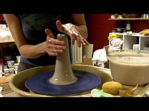 center - This is an instructional pottery video on how to center clay on the potters wheel by Janis Hughes in the Evolution Stoneware Pottery studio. Check out www.ev...