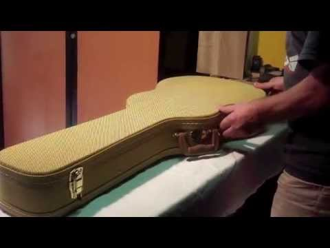Pose de sangles sur housse rigide de guitare électrique pour la porter à dos
