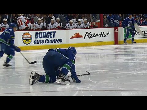 Video: Boeser crawls & scrambles to bench after blocking hard shot with foot