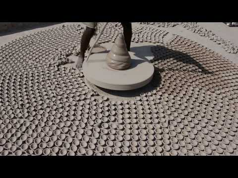 Guy makes hundreds of small clay pots. [02:21]