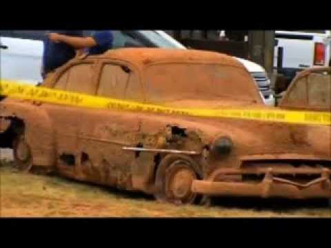 2 cars containing 6 bodies that sank a decade apart are found in a lake after 40 years