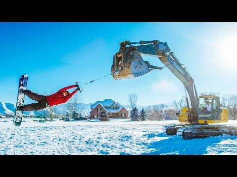 Kaivuri pyörittää lumilautailijoita upealla videolla
