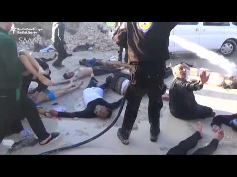 這位敘利亞爸爸緊緊抱住的雙胞胎已經死去