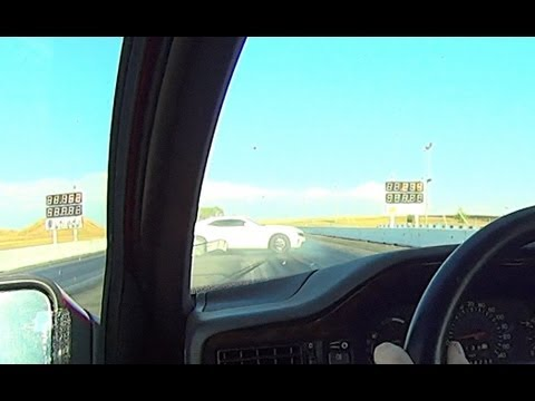 ZL1 spins out, hits wall going down the strip