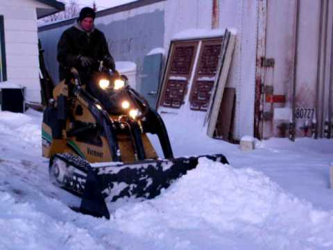 Mini Skidsteer Pushes Snow