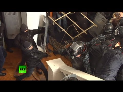 Video Violent video: Ukraine rioters brutally beat police, storm local admin building download in MP3, 3GP, MP4, WEBM, AVI, FLV January 2017