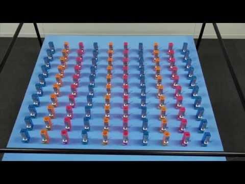 100 Metronomes Synchronizing
